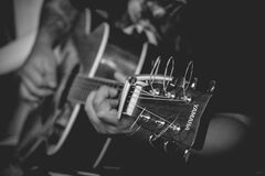 Musician playing acoustic guitar Royalty Free Stock Images