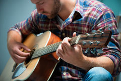 Musician playing acoustic guitar. Close up of a male musician playing acoustic guitar Royalty Free Stock Photography