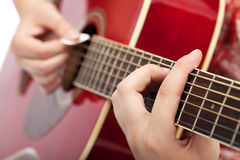 Musician playing on acoustic guitar Stock Images