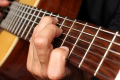 Musician playing an acoustic guitar Stock Photos