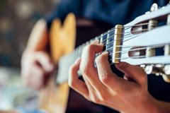 Young musician playing acoustic guitar Stock Photo