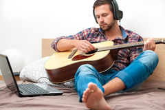 Musician playing acoustic guitar stock images