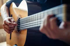 Musician playing acoustic guitar Stock Photo