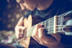 Musician playing acoustic guitar Royalty Free Stock Image