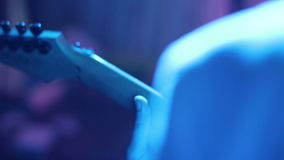 Musician playing bass guitar in a disco lights. stock footage