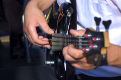 Musician playing bass guitar focus on right hand. Close up view musician playing bass guitar focus on right hand Royalty Free Stock Images
