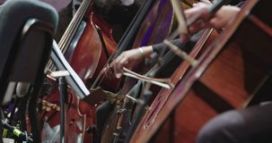 Musician playing cello during a classical music rehearsal before a concert. Musician playing cello during a classical music rehearsal before an important concert stock footage
