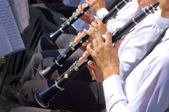 Musician playing clarinet in street orchestra Royalty Free Stock Photography