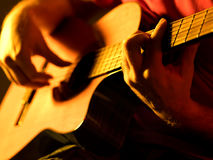 Musician playing classic guitar on a stage Royalty Free Stock Photography