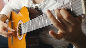 Musician playing a classical guitar in slow motion stock video footage