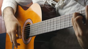 Musician playing a classical guitar in slow motion stock video
