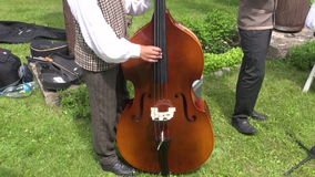 Musician playing with contrabass in agriculture fair stock video