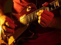 Musician  playing on guitar Stock Photos