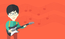 Musician playing electric guitar Stock Image