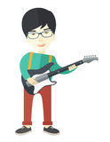 Musician playing electric guitar Stock Photography