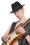 Musician playing on electric guitar Stock Photo