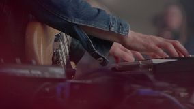 Hands of musician. The musician playing the electric piano, electric piano, closeup shot of an actor playing on the keyboard synthesizer piano keys stock footage