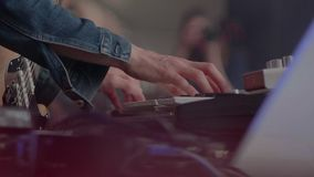 Hands of musician. The musician playing the electric piano, Electric piano,closeup shot of an actor playing on the keyboard synthesizer piano keys stock video