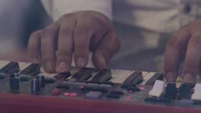 The musician playing the electric piano, Electric piano, Actor playing on the keyboard synthesizer piano keys. Musician stock video