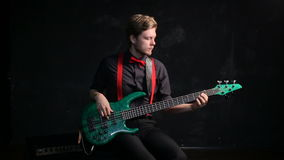 Musician playing electrical bass giutar stock footage