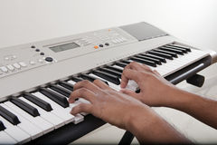 Musician playing electronic piano Royalty Free Stock Photos