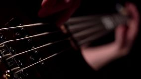 Musician playing five string electric bass guitar macro. Musician playing five string electric bass guitar stock video