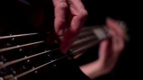 Musician playing five string electric bass guitar macro. Musician playing five string electric bass guitar stock footage