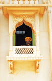 Musician playing flute through window rajasthan india Royalty Free Stock Images