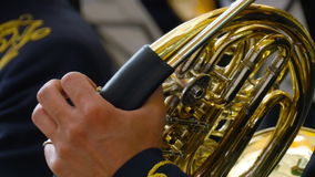 Musician playing the French horn, closeup stock video footage