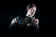 Musician playing French horn Stock Image