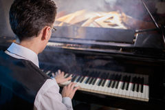 Musician playing the grand piano Stock Image