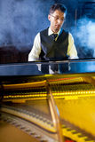Musician playing the grand piano Royalty Free Stock Images