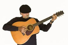 Musician playing guitar. A middle aged musician plays his guitar for the audience royalty free stock photos