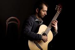 Musician playing guitar Stock Photography
