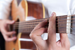Musician playing the guitar Stock Photo