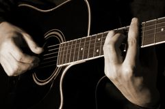 Musician playing guitar. Isolated on black Royalty Free Stock Photography