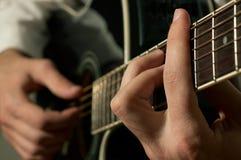 Musician playing guitar stock photos