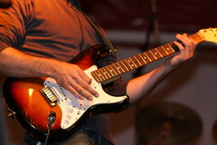Musician playing guitar Royalty Free Stock Photography