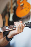 Musician playing a guitar Stock Image