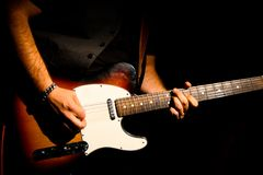 Musician playing the guitar in a concert stock images
