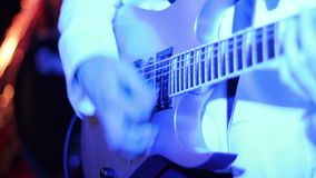 Musician playing guitar in a disco lights stock footage