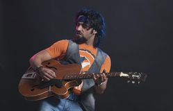Musician playing a guitar Royalty Free Stock Photography