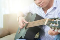 Musician playing guitar royalty free stock photo