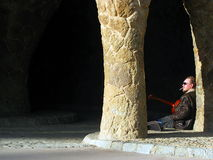 A musician playing the guitar in the Park Guell Stock Photography