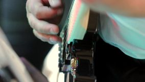 Musician playing the guitar at the party stock footage