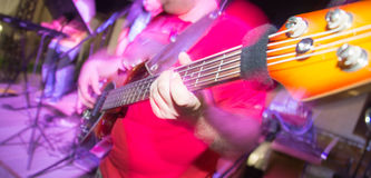 Musician playing guitar in a rock band.  Royalty Free Stock Photos