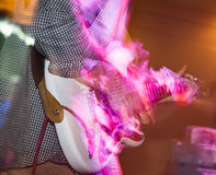 Musician playing guitar in a rock band.  Stock Photos