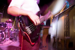 Musician playing guitar in a rock band.  Stock Images