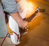 Musician playing guitar in a rock band.  Royalty Free Stock Photo