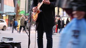 Musician playing guitar street Vancouver stock video